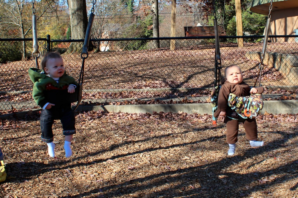 swinging on a playdate in the park