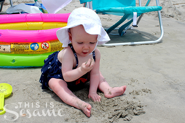 8-months-eating-sand-on-the-beach